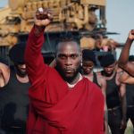"Burna Boy Explores Systemic Racism & Its Effects In ""Monsters You Made"" Video Ft. Chris Martin 